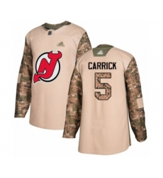 Men's New Jersey Devils #5 Connor Carrick Authentic Camo Veterans Day Practice Hockey Jersey